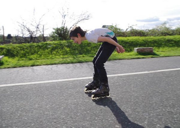 Boy rollerblading on the road