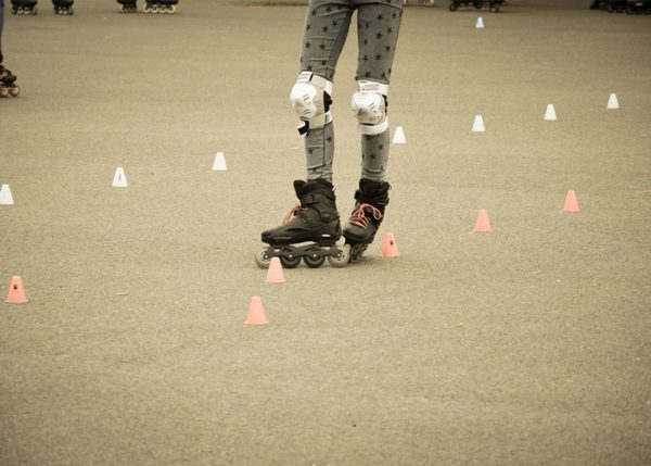person rollerblading through obstacles
