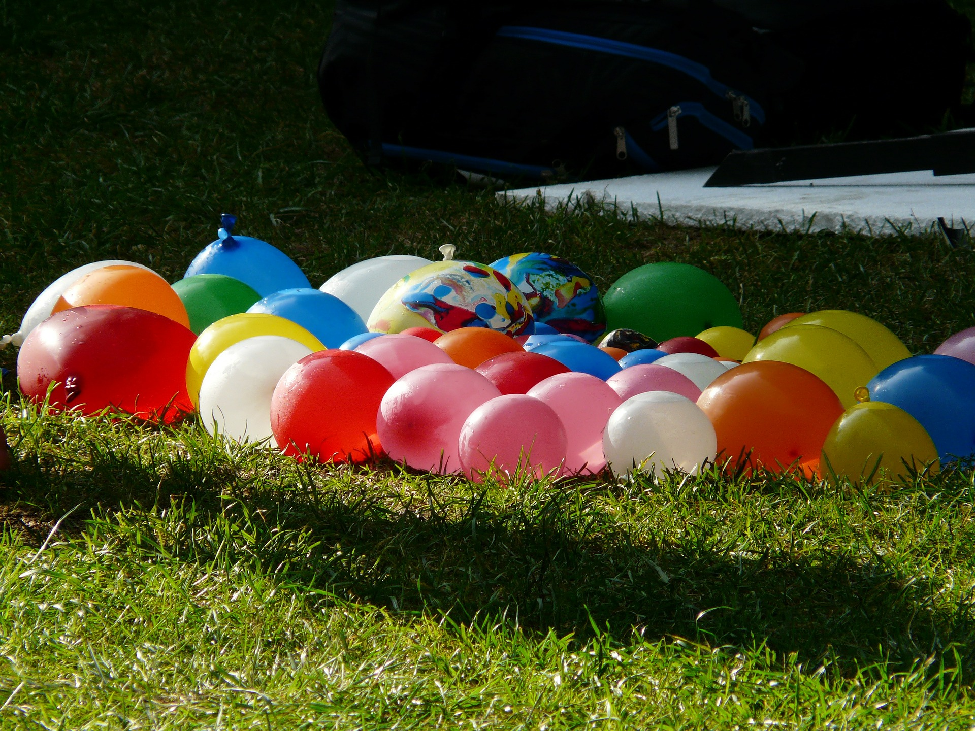 Water balloons placed in the grass field