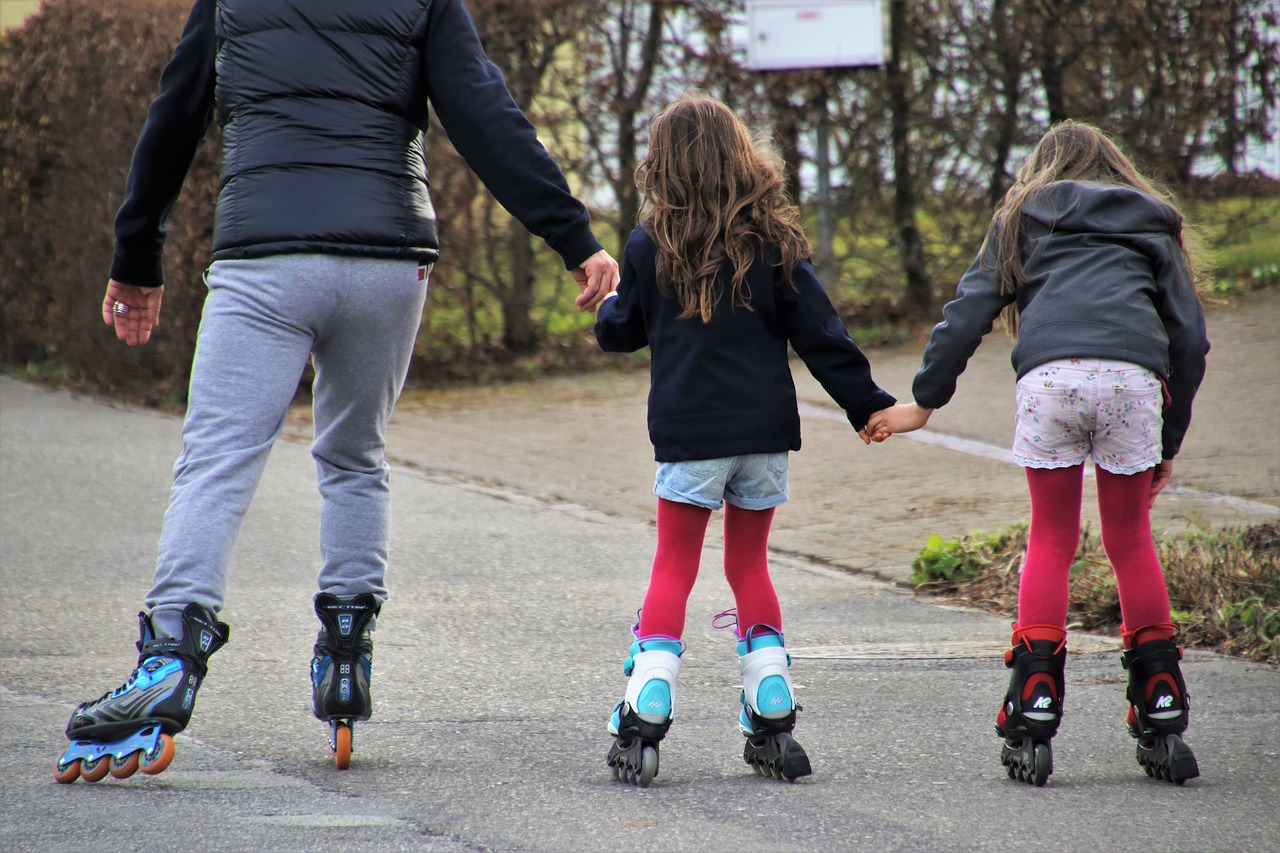 adult and two children wearing pairs of the best rollerblades